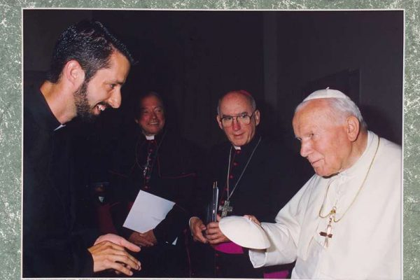 "Father Richard Kunst and Pope John Paul II on one of his first audiences, attempting to ""swap a zucchetto."""