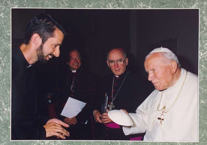 """Father Richard Kunst and Pope John Paul II on one of his first audiences, attempting to """"swap a zucchetto."""""""