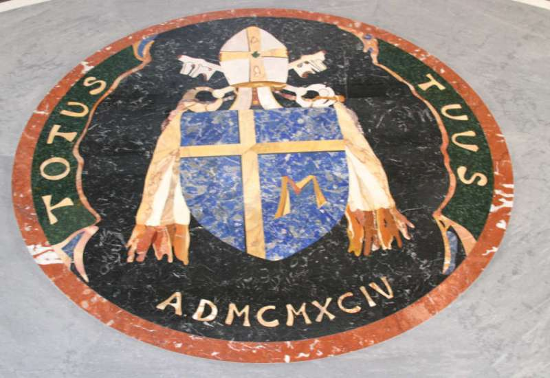 The Coat of Arms of Saint John Paul II Replacing the Marble Flooring in St. Peter's Basilica