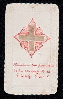 Holy Card With a Piece of Cassock of Blessed Pius IX in the Shape of a Cross