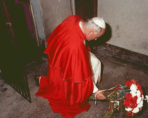 Pope John Paul II in the Auschwitz cell of Maximillian Kolbe