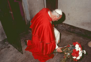 Pope John Paul II in Fr. Maximilian Kolbe's cell in Auschwitz