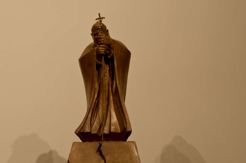 Statue of Saint John Paul II on top of the reliquary cabinet