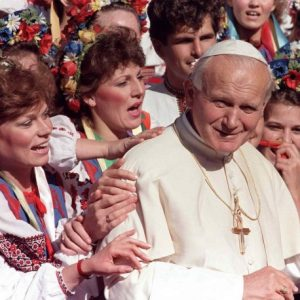 A group of girls dressed in traditional Ukranian dress hold on to the shoulder of Pope Paul II outside the saints Vladimir and Olga Cathedral in Winnipeg on Sept. 16, 1984. Pope Francis has cleared John Paul II for sainthood, approving a miracle attributed to his intercession. THE CANADIAN PRESS/Jose More
