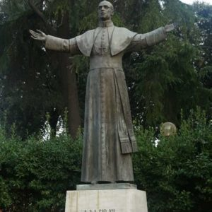 Pope Pius XII near St. Lawrence Outside the Walls, Rome, after the bombing of the railway station