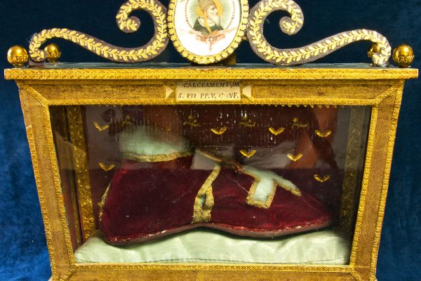 Pope St. Pius V: A Papal Red Slipper in an Ornate Case